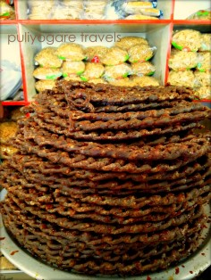 Beautifully arranged Karupatti mittai (Palm jaggery) to form a tower. Almost looks like braided hair