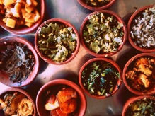 Various types of spinach, vegetables cooked using cold pressed sesame oil served in mud pots. — at Trichy Tamilnadu.