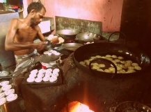 One of the employees making these fried wonders. I swear that kitchen was hot as a furnace! — in Manaparai, Tamil Nadu, India.