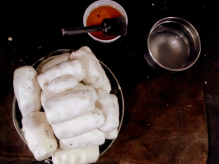 Rice flour mixed with salt, cumin seeds, sesame seeds, oil, ajwain and water rolled into balls before it goes into the extruder, — in Manaparai, Tamil Nadu, India.