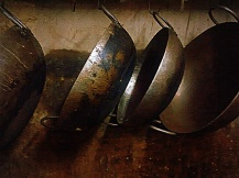 The woks/kadais used to fry the seeval. Doesn't it look like an art installation?