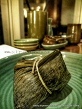 Zongzi. Glutinous rice stuffed with vegetarian and non vegetarian fillings and wrapped in bamboo leaves, tied and steamed or boiled
