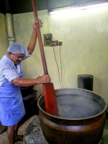 Milk from all purpose flour (maida) is extracted and added to boiling sugar syrup and continuously stirred using an old wooden spatula
