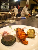 Veg kebab sampler (L-R) Palak aur singada tikka: Spinach and green peas mixture cooked with homemade masala, stuffed with water chestnut, cheese and green chili then cooked in the hot griddle. Kitabhi aloo: Red chili and Indian spiced Hassel back potato cooked in charcoal oven Bhatte ki paneer: Cottage cheese spiced up with Bhatti masala and cooked in charcoal oven